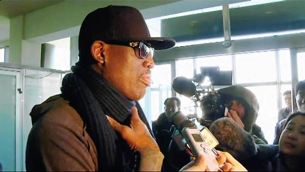 Former U.S. NBA basketball player Dennis Rodman speaks to the media at the airport before departing Pyongyang in this still image taken from video. Rodman watched a basketball match with North Korean leader Kim Jong-un and his wife Ri Sol-ju in Pyongyang on Thursday