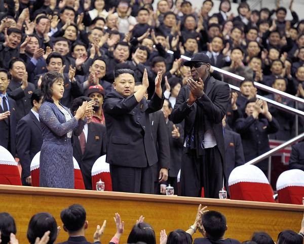 North Korean leader Kim Jong-Un (C), his wife Ri Sol-Ju (L) and former NBA basketball player Dennis Rodman clap during an exhibition basketball game in Pyongyang in this undated picture released by North Korea's KCNA news agency. KCNA reported that a mixed basketball game of visiting U.S. basketball players and North Korean players was held at Ryugyong Jong Ju Yong Gymnasium in Pyongyang