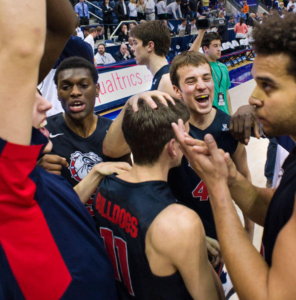 The Gonzaga Bulldogs celebrate their win over the Brigham Young Cougars after the game at the Marriott Center.