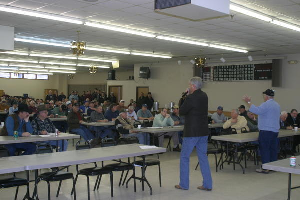 Val Jark, auctioneer for Jark/Worlie Auction, elicits bids during a land auction at the Eagles Club in Aberdeen.