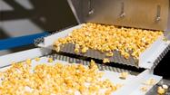 Popcorn on a conveyor at The Popcorn Factory