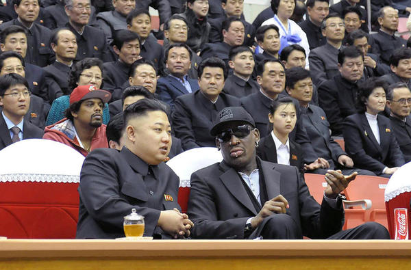This photo taken on February 28, 2013 and released by North Korea's official Korean Central News Agency (KCNA) on March 1, 2013 shows North Korean leader Kim Jong-Un (front L) and former NBA star Dennis Rodman (front R) speaking at a basketball game in Pyongyang. Flamboyant former NBA star Dennis Rodman has become the most high-profile American to meet the new leader of North Korea, vowing eternal friendship with Kim Jong-Un at a basketball game in Pyongyang.