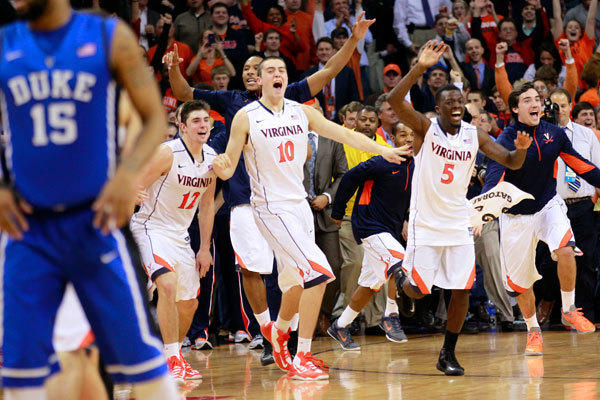 Virginia Cavaliers players celebrate after their game against the Duke Blue Devils at John Paul Jones Arena. The Cavaliers won 73-68.