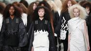 PARIS -- A rush of wind and billowing smoke at the top of the runway signaled a new mood for Rick Owens. The California-raised, Paris-based designer who made his name on second-skin leathers with a dark and moody bent showed his fall 2013 collection Thursday afternoon during Paris Fashion Week.