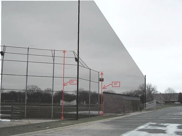 This image provided by New Trier High School roughly shows what the netting system it wants to install around a baseball backstop at the corner of Hibbard and Willow Roads would look like.