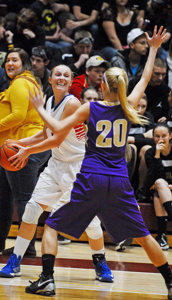 Emily Fox of Lincoln County looks for an open teammate after getting cornered by Somerset's Jessica Wallace during Lincoln's 62-43 victory over Somerset on Thursday in a girls 12th Region Tournament first-round game at Pulaski County. Fox led Lincoln with 19 points, four rebounds, two steals and two assists.