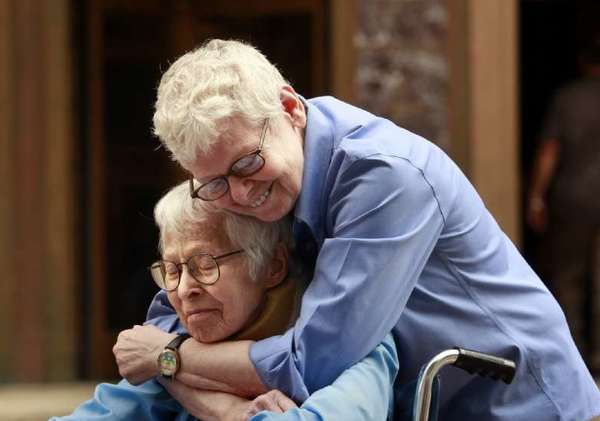 The first couple to wed under New York state's same-sex marriage law, Connie Kopelov, age 85, sitting, and Phyllis Siegel.