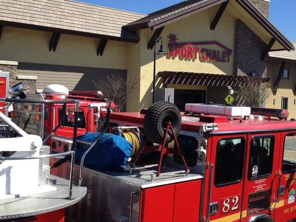Fire crews respond to the Sport Chalet in La Canada, where authorities said an explosion hurt two employees.