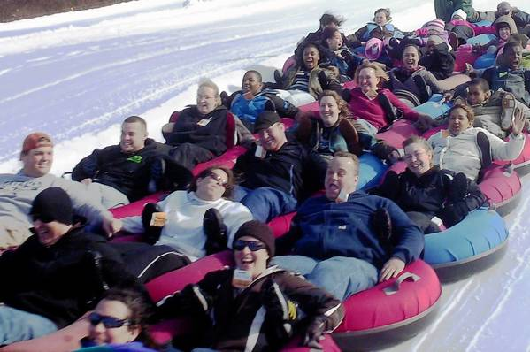 Tubing is not just a solo acitivity at Amesbury Sports Park in Amesbury, Mass. Group tubing is popular with people locking arms and legs to make the downhill trip.