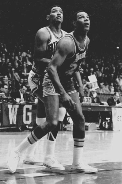 All-time basketball great Elgin Baylor of the visiting Los Angeles Lakers boxes out Chicago's Bob Boozer, during a game in Chicago, 1967. (Photo by Robert Abbott Sengstacke/Getty Images)