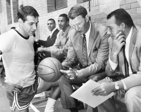 Asst coach Al Bianchi, head coach John Kerr and owner of teh Bulls Dick Klein in the Merner Gym at North Central College in Naperville at a team practice Sept 15, 1966. (Tribune photo by James Mayo.)