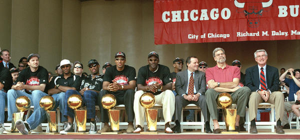 The Chicago Bulls celebrate their sixth NBA title during a rally in Grant Park June 16, 1998, in Chicago. From left; Tony Kukoc, Ron Harper, Dennis Rodman, Scottie Pippen, Michael Jordan, Mayor Richard M. Daley, coach Phil Jackson and Gov. Jim Edgar.(Tribune file photo)