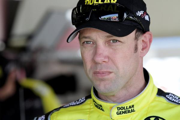 Matt Kenseth, driver of the No. 20 Dollar General Toyota, stands in the garage area during practice for the NASCAR Sprint Cup Series Daytona 500 at Daytona International Speedway in Florida.