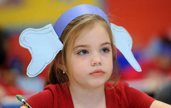 "Kindergarten student Lena Marks, 5, listens during a class exercise. She is wearing the Horton the Elephant character ears made popular by Dr. Seuss which she made.   Gockley Elementary School students celebrated ""Read Across America"" day on Friday which is childrens author Dr. Seuss's birthday."