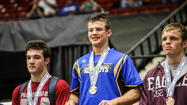 Kissimmee Osceola's Fox Baldwin, shown on the awards podium at the state tournament in Lakeland, is the All-Central Florida Wrestler of the Year. He led the Kowboys to the No. 1 spot in the final Super Six. (Joshua C. Cruey, Orlando Sentinel)