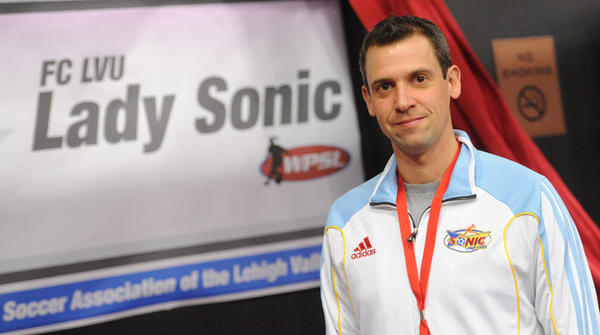 New head coach of the Lady Sonic soccer team is Adam Hayne, posing here at the team's booth.     The G.I.O. Soccer Coaches Clinic and Expo is being held Feb. 28-March 2 at the Sands Casino and Resort Event Center in Bethlehem.