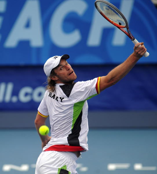Frank Moser  playing with  Xavier Malisse  returns a backhand to the doubles team of Max Mirnyi and Horia Tecau Friday at the Delray Beach International Tennis Championships.