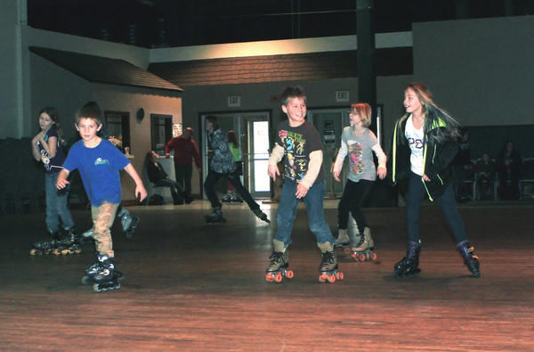 A group of young skaters have fun roller skating at the Harvest Barn Church in East Jordan. The rink on M-66 near Glen's Market is open weekly on Saturdays throughout the winter.