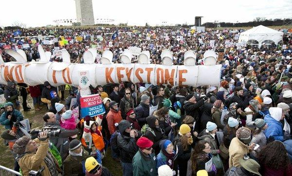 Protesters gather at the National Mall in Washington last month to oppose the Keystone XL oil pipeline. A draft of a new State Department review says the project's effect on the environment would be minimal.