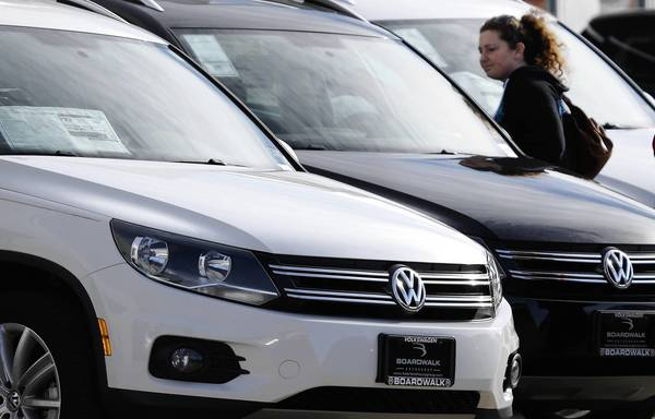 Meredith Havens looks at Volkswagens at a dealership in Richardson, Texas.
