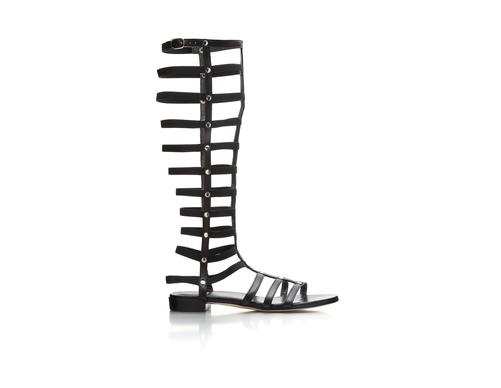 Stuart Weitzman black leather gladiator sandal.