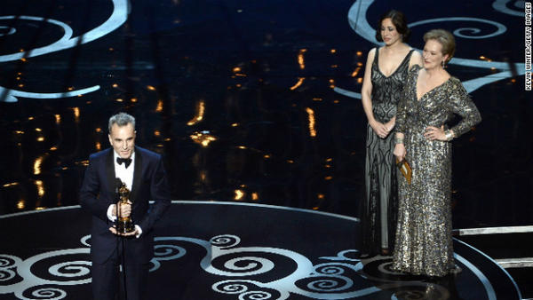 "Daniel Day-Lewis accepts the Oscar for lead actor in ""Lincoln."""