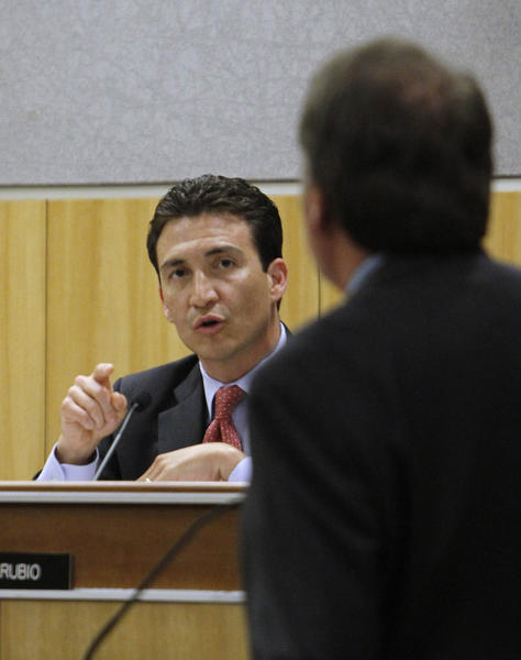 Former state Sen. Michael Rubio ( D-Shafter), left, during a hearing before he resigned.