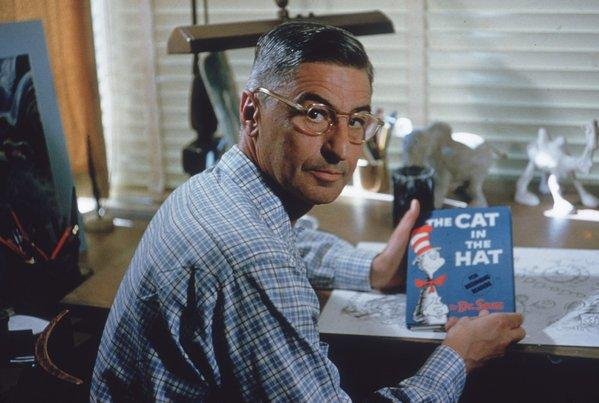 "In 1957, author and illustrator Dr Seuss (Theodor Seuss Geisel, 1904-91) sits at the drafting table in his home office in La Jolla, Calif. He holds a bestseller: ""The Cat in the Hat."""