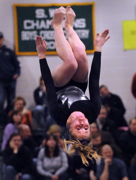 Lauren McCormick of Glastonbury High School, one of the top gymnasts in the state, performs her routine on the balance beam during the State Open high school girls gymnastics championships held at New Milford High School Friday night. McCormick scored an 8.9 on the beam.