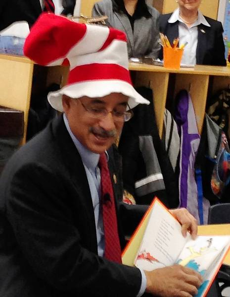 "U.S. Rep. Robert C. ""Bobby"" Scott wears a ""Cat in the Hat"" hat while reading to 4-year-olds at the Hampton Avenue Head Start program in Newport News."