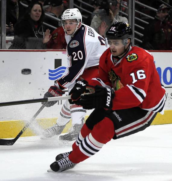 The Blue Jackets' Tim Erixon and Marcus Kruger chase the puck in the first period.