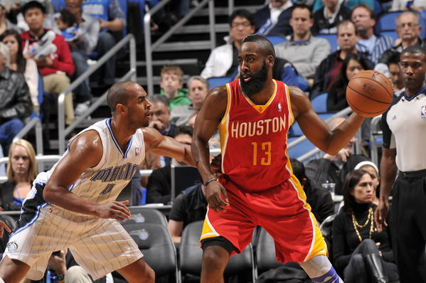 James Harden (13) of the Houston Rockets looks to pass the ball against Arron Afflalo (4) of the Orlando Magic.