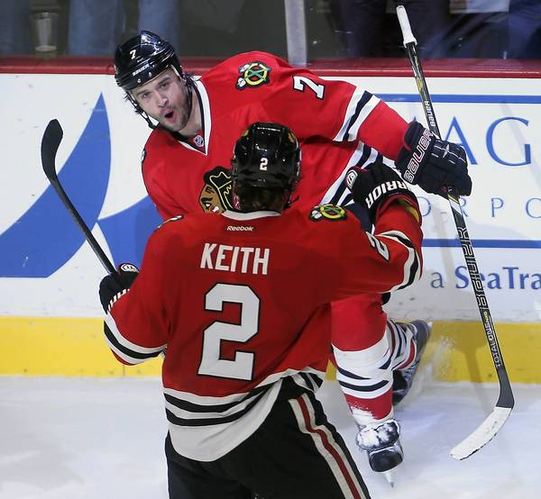 Brent Seabrook celebrates his game-winning goal with Duncan Keith.
