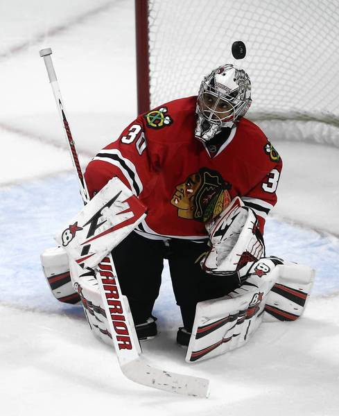 Blackhawks goalie Ray Emery makes a save in overtime.