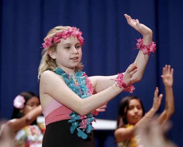 "Abigail Powell dances to a Hawaiian song along with other members of the Hula Club during a performance of ""Making A Difference With The Aloha Spirit"" at Roosevelt Elementary School in Burbank."
