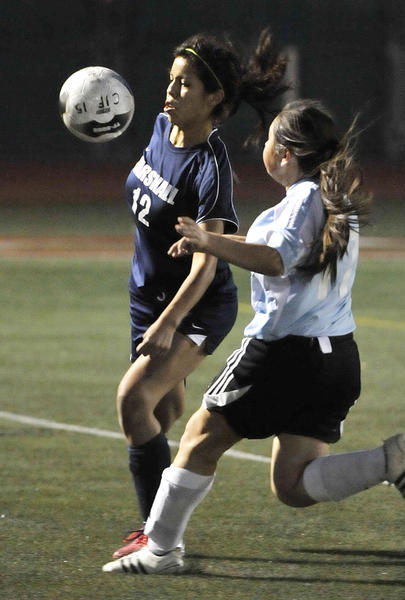 Marshall Fundamental's Jennifer Lopez battles for control of the ball against Arroyo in the CIF Southern Section Division VII girls soccer championship match at Warren High School in Downey on Friday, February 28, 2013. Marshall won the championship game 2-0, scoring two goals in the second half.