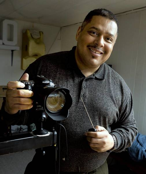 Laurel photographer Matthew Coates predicts some local businesses could feel losses when federal budget cuts become reality.