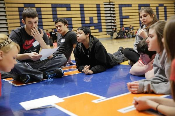 Oswego High School students discuss the impact of hazing after Alice Haben spoke about her son Nick, a college student who died during an initiation ritual in 1990.