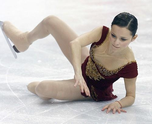 Sasha Cohen of the United States, the leader going into the free skating portion of the women's figure skating competition, falls during her routine.