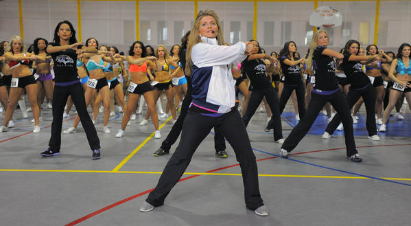 Dance team coach Keren Kreitzer leads hopefuls with instructions and moves during tryouts for the Ravens cheerleaders squad at the Midtown Athletic Club Saturday, Mar 2, 2013.