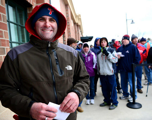 Kyle Grube of Easton leaves the ticket booth with his tickets Saturday morning. He was first in line and arrived at 3:30 a.m..    Saturday was a celebration of National Pig Day and it was the first day of single game ticket sales for the Lehigh Valley IronPigs at Coca-Cola Park.