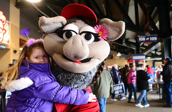 IronPigs mascot Fefe holds Samantha Landry, 4, of Emmaus.    Saturday was a celebration of National Pig Day and it was the first day of single game ticket sales for the Lehigh Valley IronPigs at Coca-Cola Park.