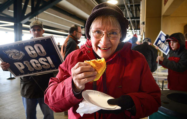 IronPigs fan Theresa Wendland of Coplay enjoys her pulled pork sandwich.    Saturday was a celebration of National Pig Day and it was the first day of single game ticket sales for the Lehigh Valley IronPigs at Coca-Cola Park.