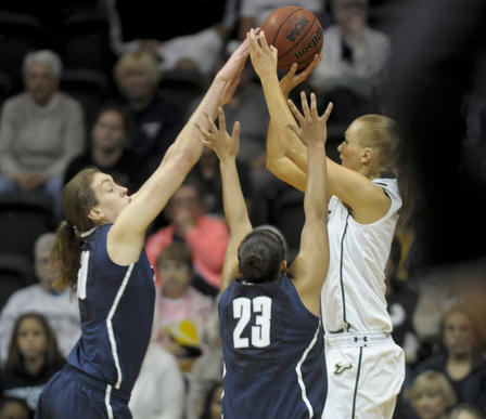 Breanna Stewart, left and Kaleena Mosqueda-Lewis UConn block Inga Orekhova's shot in the second half on Saturday against the University of South Florida Bulls at the Sun Dome in Tampa. UConn defeated the Bulls 85-51.