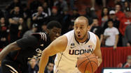Without Shabazz Napier, the Huskies did most of the things they usually do with him. They grappled, scrambled back from behind and gave themselves a chance to win another game.
