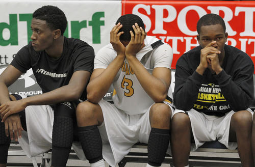 American Heritage players react during the final seconds during a high school 5A state basketball championship game on Saturday,  Mar. 2, 2013 in Lakeland, Fla. Jesuit defeated American Heritage 79-58. (Photo/Reinhold Matay)