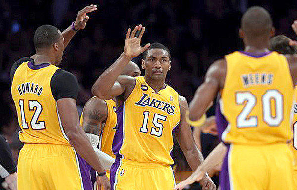 Metta World Peace receives high-fives from his teammates after making a basket during the Lakers' 111-107 victory over the Portland Trail Blazers.