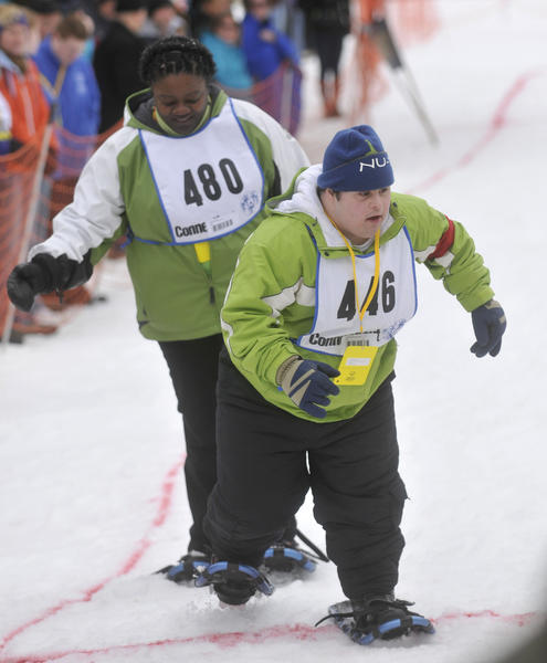 Gregory Locke, of Oxford, competes in a unified show shoe relay event at the Special Olympics Winter Games held at the Connecticut Light & Power grounds in Simsbury Saturday.