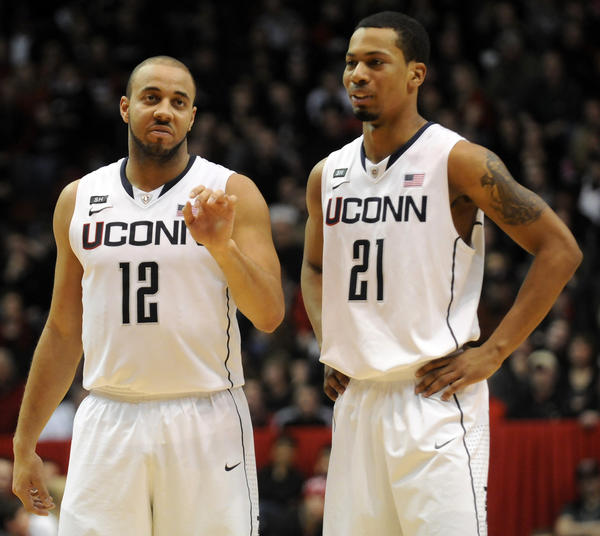 UConn guard R.J. Evans, left, scored just two points starting in place of an injured Shabazz Napier, whiel Omar Calhoun struggled with just three points, the first bucket of the game, in a 61-56 loss to Cincinnati at the Fifth Third Arena Saturday afternoon.