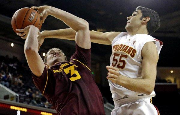 Arizona State center Eric Jacobsen is fouled by USC center Omar Oraby on a shot in the first half Saturday.
